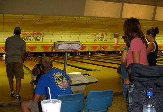 Tim bowling with Jackson, Dallas, Lauren, Tiffany and Heather looking on